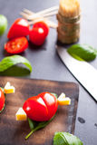 Marinated fillet with tomato heart shaped. Royalty Free Stock Photo