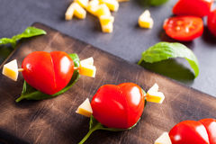 Marinated fillet with tomato heart shaped. Royalty Free Stock Photos