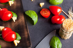 Marinated fillet with tomato heart shaped. Royalty Free Stock Image