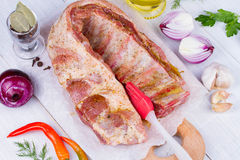 Marinated Fresh Raw Pork Ribs, Olive Oil, Chili Pepper, Red Onion And Greens on Wooden Background. Marinated Fresh Raw Pork Ribs, Olive Oil, Chili Pepper, Red Royalty Free Stock Photography