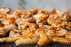Marinated, fried with a crispy golden crust fried chicken wings Royalty Free Stock Photo