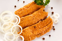 Marinated fried herring fillets Stock Image