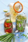 Marinated fruits and vegetables. In glass jar stock image