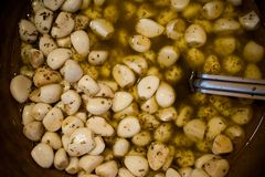 Marinated garlic and olives on provencal street market in  France. Royalty Free Stock Images