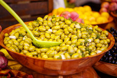 Marinated garlic and olives on provencal street market in Proven Royalty Free Stock Images
