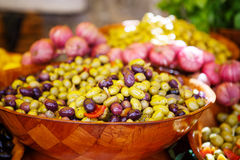 Marinated garlic and olives on provencal street market in Proven Stock Images