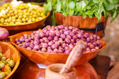 Marinated garlic and olives on provencal street market in Proven Stock Photography