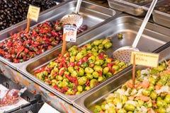 Marinated garlic, spices and olives on provencal street market i stock photos