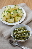 Marinated green beans and boiled potatoes Stock Photo