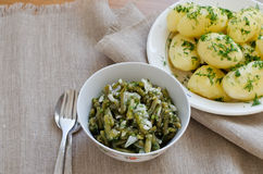 Marinated green beans and boiled potatoes Stock Image