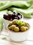 Marinated green and black olives (Kalamata) Stock Photos