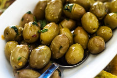 Marinated green olives in bowl stock photo