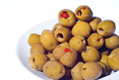 Marinated green olives in bowl royalty free stock images