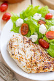 Marinated Grilled Healthy Chicken Breast served with Fresh Salad stock photo