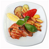 Marinated grilled pork loin with vegetables Stock Images