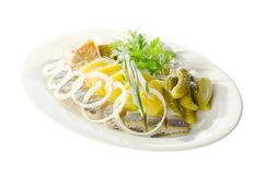Marinated herring. With potato on plate Royalty Free Stock Image