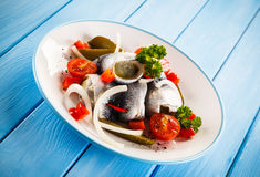 Marinated herring fillets Stock Images