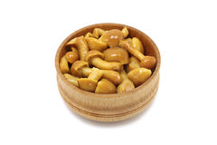 Marinated honey mushrooms in a wooden bowl Stock Photo