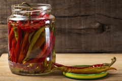 Marinated hot peppers in jar Royalty Free Stock Photos