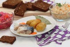 Marinated mackerel and the baked potato. Simple dish - a marinated mackerel and the baked potato Royalty Free Stock Photo