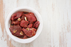 Marinated meat in white plate Stock Photography