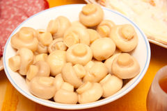 Marinated mushrooms in a bowl Stock Image
