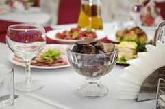 Marinated mushrooms, cut into pieces. Festive banquet stock image