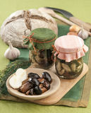 Marinated mushrooms. In a glass jar Royalty Free Stock Images