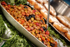 Marinated olives. Olives - different colors - marinated in a bowl Stock Images
