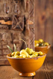 Marinated Olives in bowls with moroccan  ornament on wood Stock Images