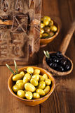 Marinated Olives in bowls with moroccan  ornament on wood Stock Photos