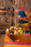 Marinated Olives in bowls with moroccan  ornament on wood Royalty Free Stock Photography