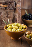 Marinated Olives in bowls with moroccan  ornament on wood Stock Image