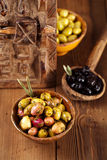 Marinated Olives in bowls with moroccan  ornament on wood Royalty Free Stock Photos