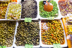 Marinated olives in cans at  market Royalty Free Stock Image