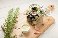 Marinated olives in a jar stock photo