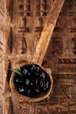 Marinated Olives in old spoon with moroccan  ornament on wood Stock Image