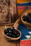 marinated Olives in old spoon Stock Photo
