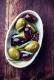 Marinated olives with rosemary Royalty Free Stock Photos