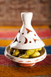 Marinated Olives in tajine bowls with moroccan  ornament on wood Stock Image