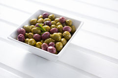 Marinated olives in white bowl Royalty Free Stock Images