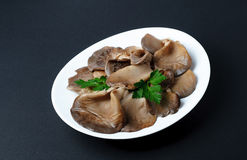 Marinated oyster mushrooms laid on a white plate Stock Photos