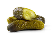 Marinated pickled cucumbers isolated on white Royalty Free Stock Photos