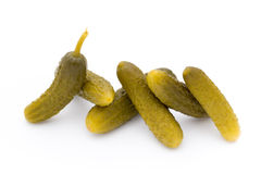 Marinated pickled cucumbers isolated on the white. Royalty Free Stock Photo