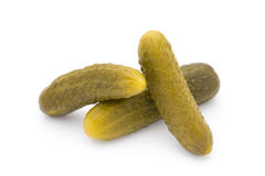 Marinated pickled cucumbers isolated on the white. Stock Photos