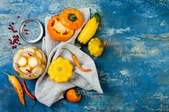 Marinated pickles preserving jars. Homemade yellow vegetables pickles. Fermented food. Top view stock images