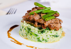 Marinated piquant sliced beef on savory rice Stock Image