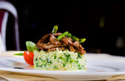 Marinated piquant sliced beef on savory rice Royalty Free Stock Image