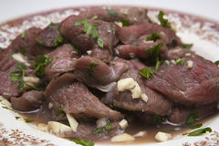 Marinated pork cheeks. (non cooked) with wine, parsley and wine Royalty Free Stock Image