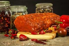 Marinated pork chop. Chilli sauce. Preparation for grilling. Fresh pork. Royalty Free Stock Photo